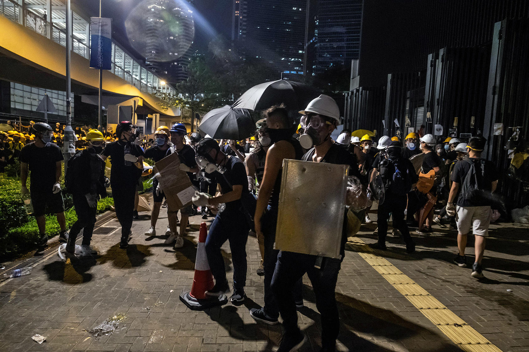 Pro-democracy demonstrators prepare to face riot police who fired tear gas outside Hong Kong's Legislative Council chambers after hundreds of protesters stormed the offices. (Lam Yik Fei/The New York Times)