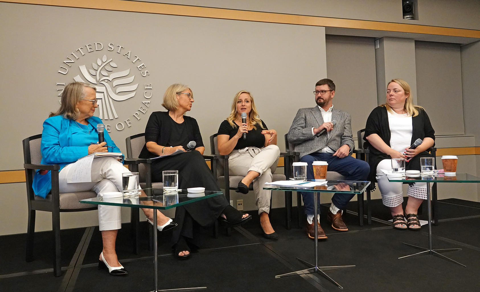 From left to right: Author Joanne Ledom-Ackerman moderates a panel of USIP's 2018 peace teachers, JoAnne Bohl, Casandra Bates, Ryan Adams and Jennifer O'Boyle, as they discuss their experiences in the program.