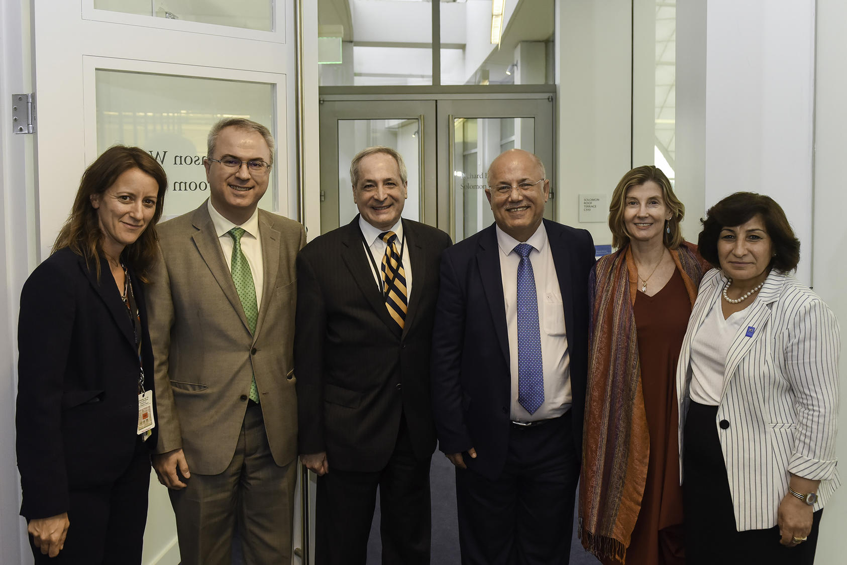 USIP's Susan Hayward, Sarhang Hamasaeed and Michael Yaffe with William Warda, USIP President Nancy Lindborg and Pascale Warda at the U.S. Institute of Peace headquarters on July 17, 2019.