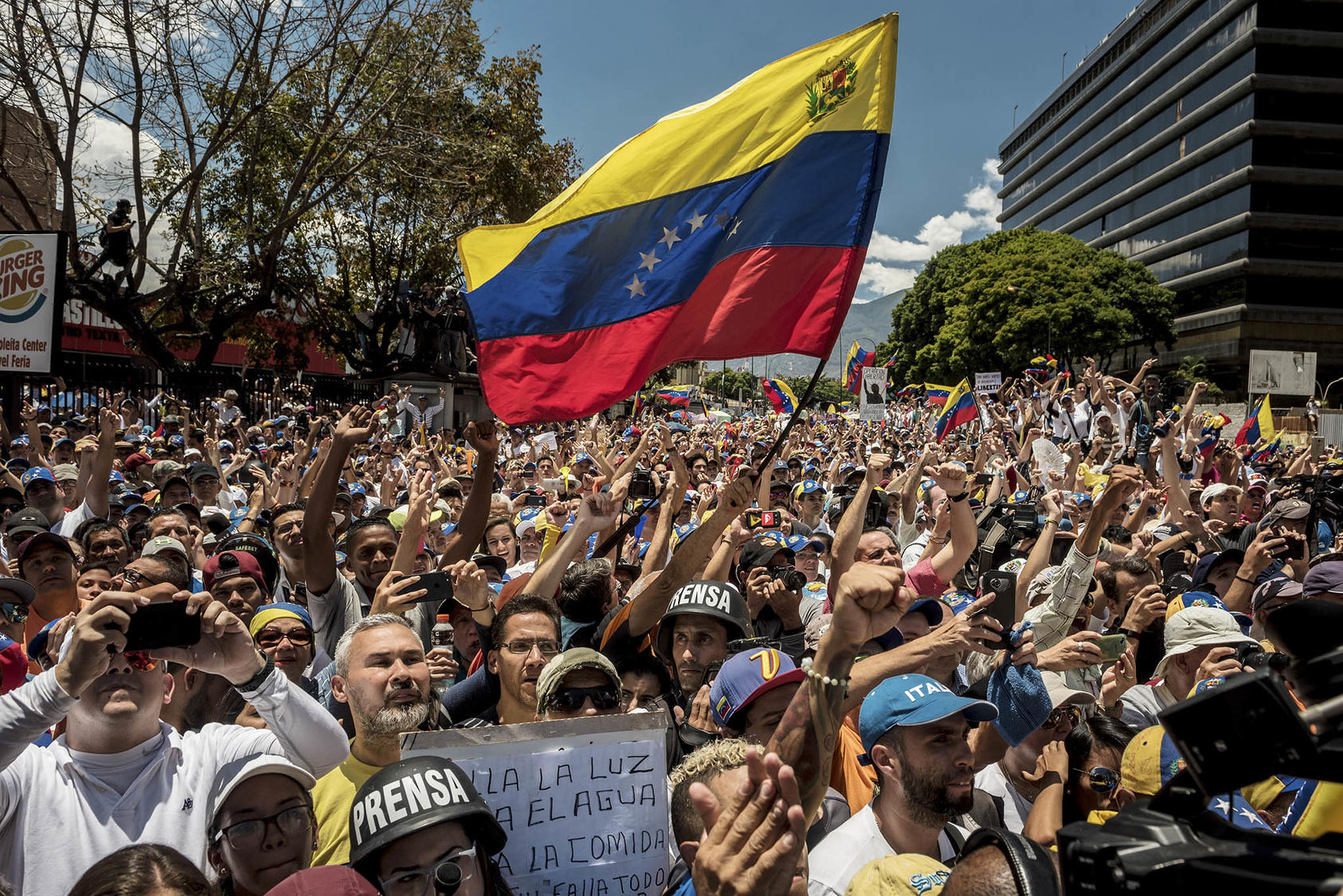 Venezuelans, most of them young, rally in April to demand a democratic transition for their country. Venezuela has a history of political protest movements led by youth. (Meridith Kohut/The New York Times)