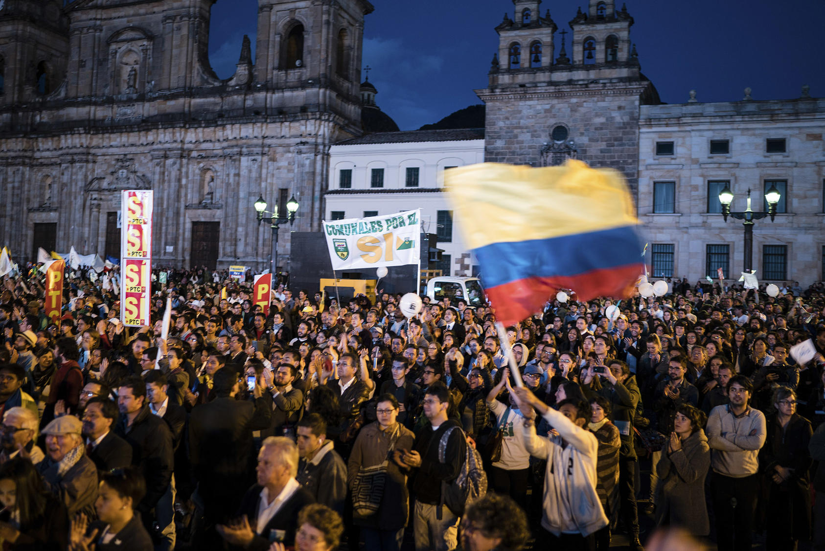 People celebrate the signing of a peace agreement between the Colombian government and the FARC, in Bogota, Sept. 26, 2016. (Federico Rios Escobar/The New York Times)