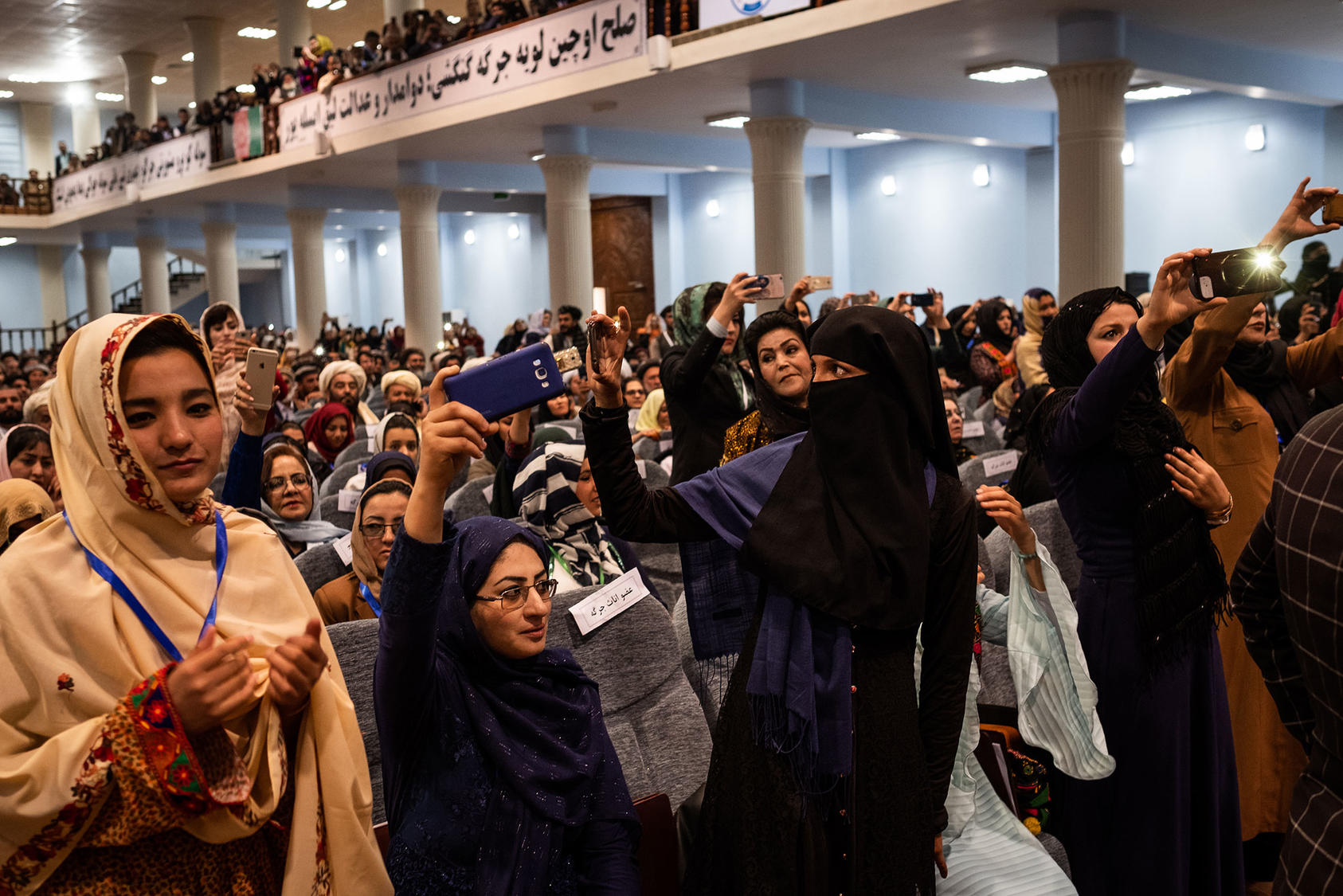 Female delegates during the opening ceremony of Afghanistan's Grand Assembly, April 29, 2019. An expected agreement between the U.S. and the Taliban to smooth future negotiations raises concerns that women may lose some freedoms. (Jim Huylebroek/The New York Times)