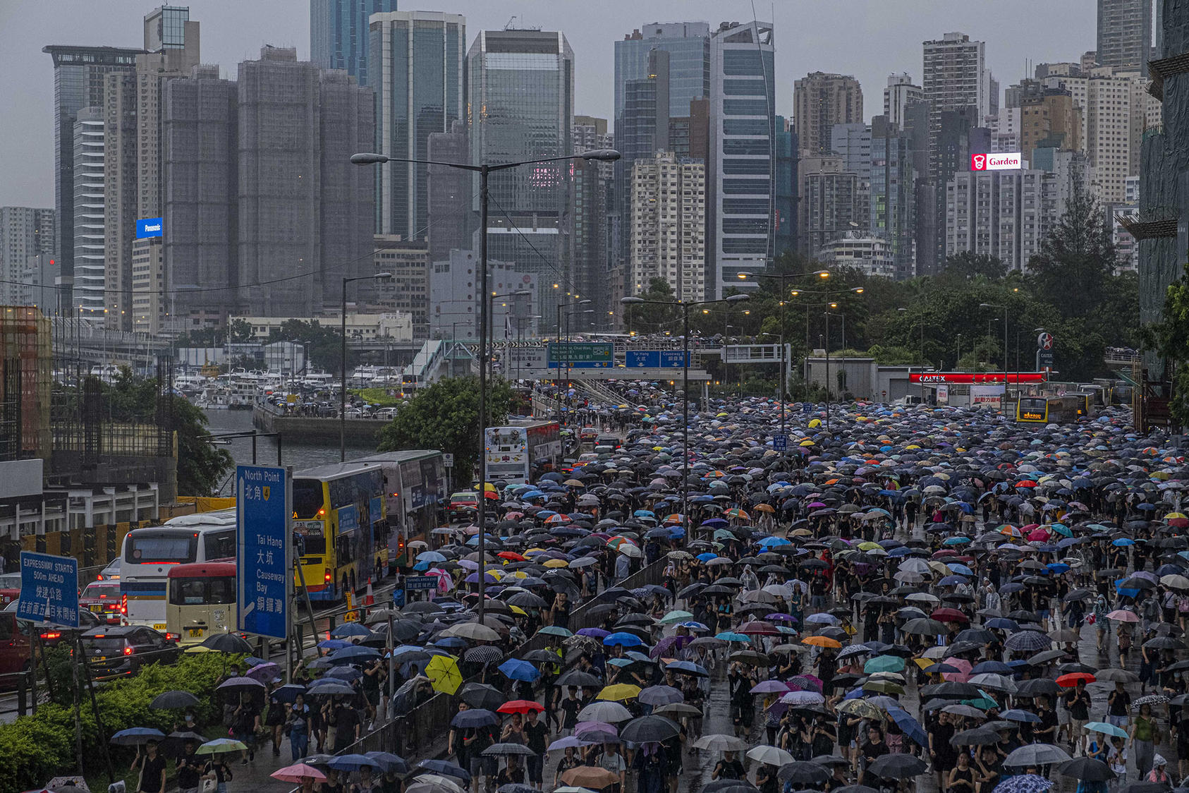 Demonstrators fill a multilane road during a march in Hong Kong on Sunday, Aug. 18, 2019. (Lam Yik Fei/The New York Times)