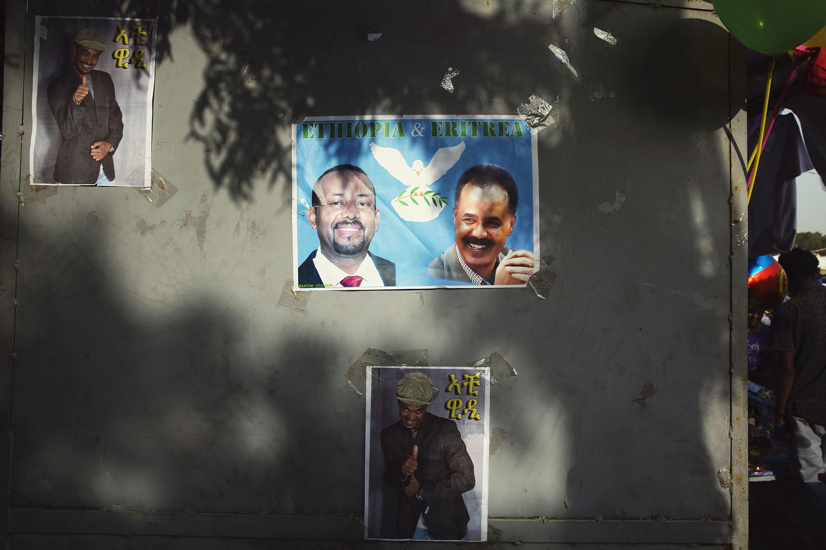 A poster of Prime Minister Abiy Ahmed of Ethiopia, left, and President Isaias Afwerki of Eritrea is displayed during a festival in Asmara, Eritrea, Sept. 7, 2018. (Malin Fezehai/The New York Times)