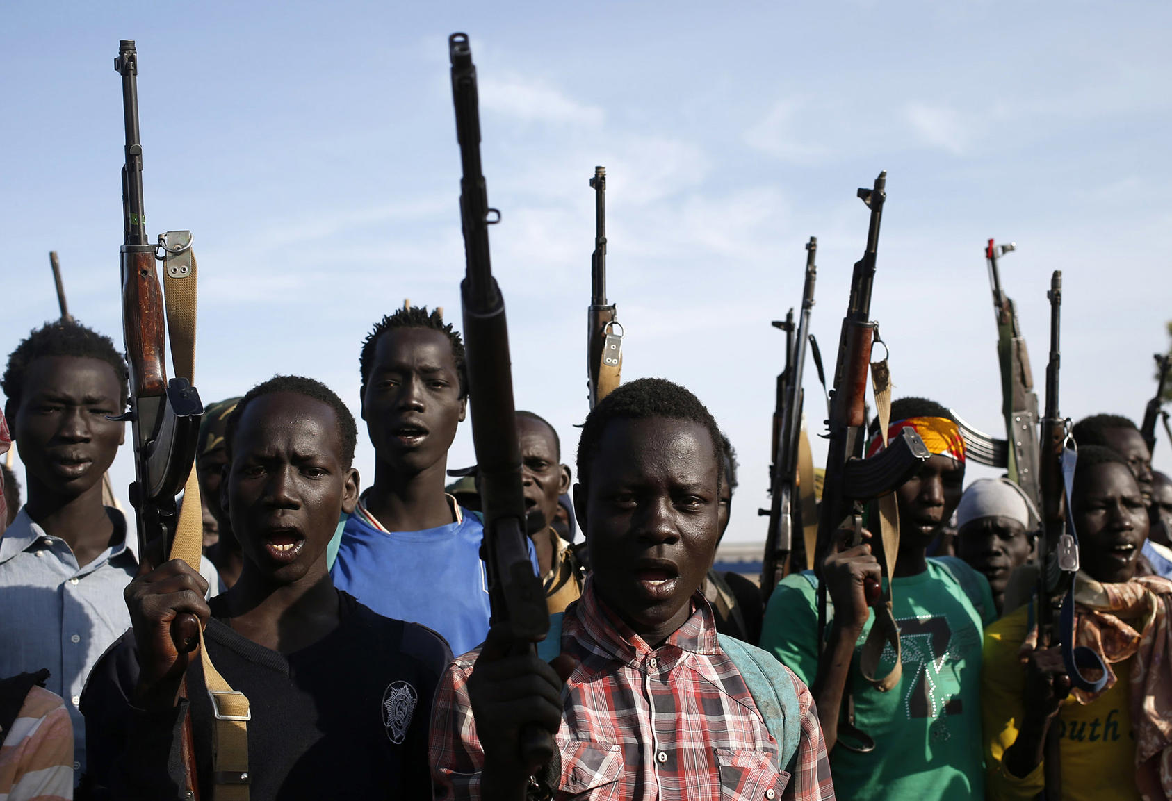 Rebel fighters hold their weapons in Upper Nile State in February 2014. (Goran Tomasevic/Reuters)