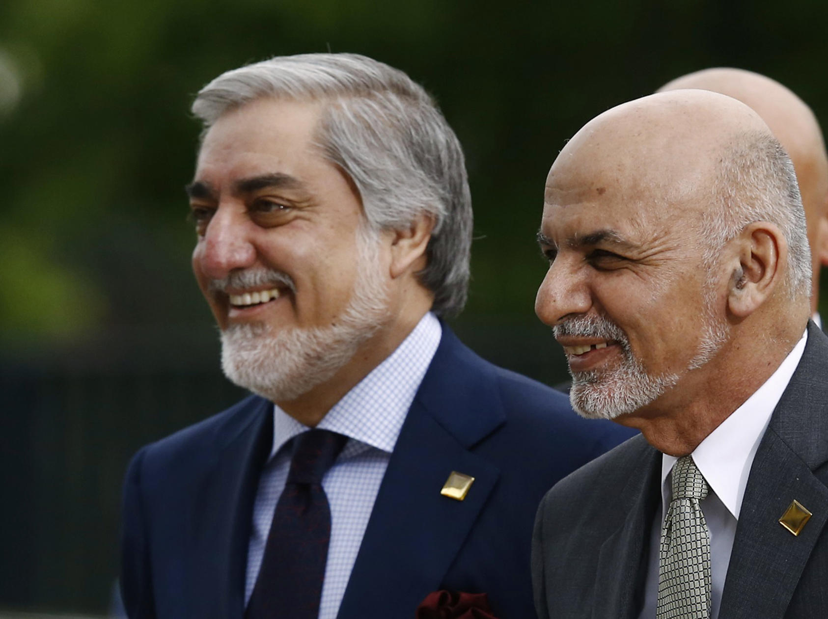 The disputed 2014 Afghan presidential election led to a power-sharing arrangement between President Ashraf Ghani (right) and rival Abdullah Abdullah. (Kacper Pempel/Reuters)