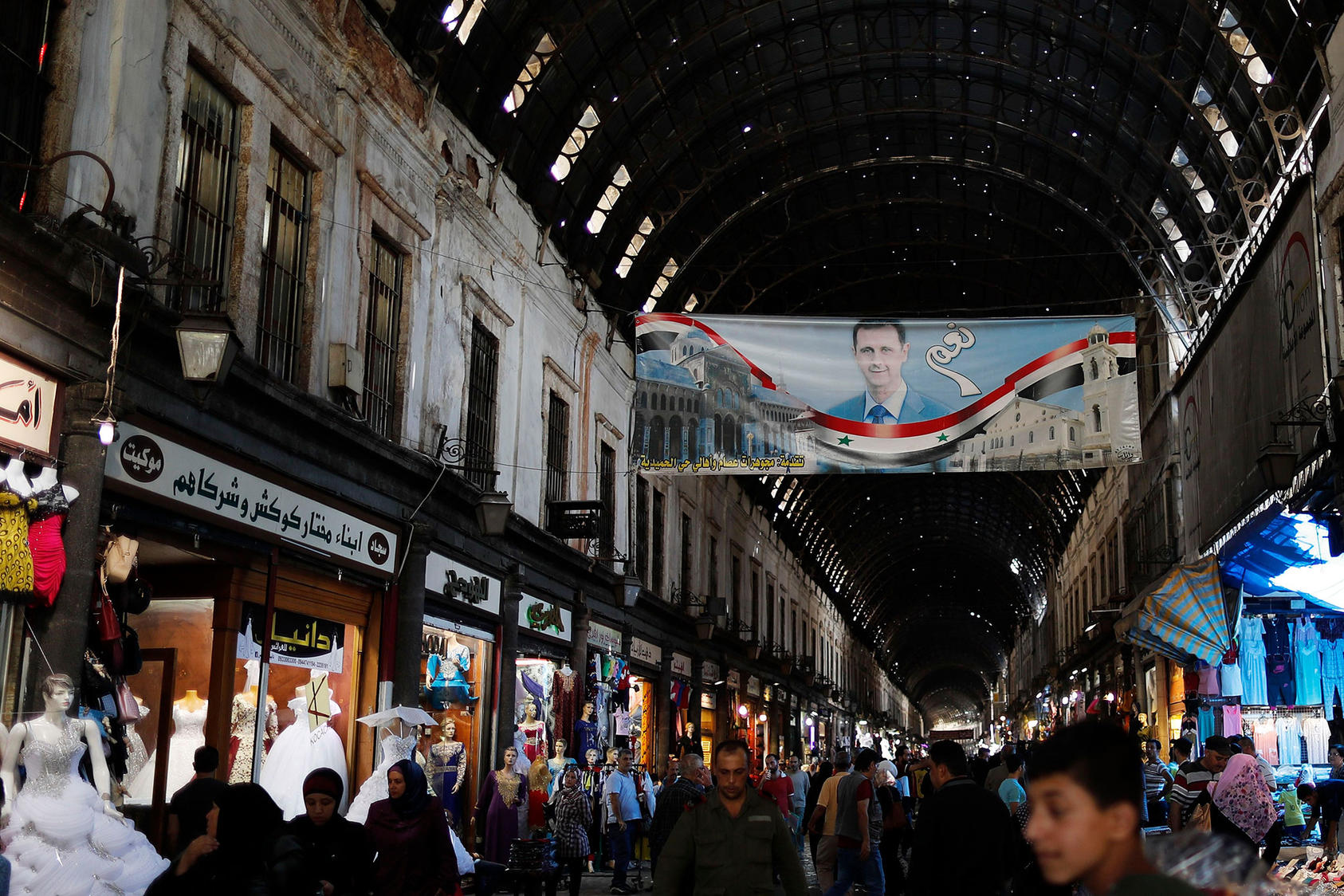 "A poster of President Bashar al-Assad with ""Yes"" in Arabic hangs in the Hamadiyah market in the Old City of Damascus. (Photo by Hassan Ammar/AP/ Shutterstock.)"