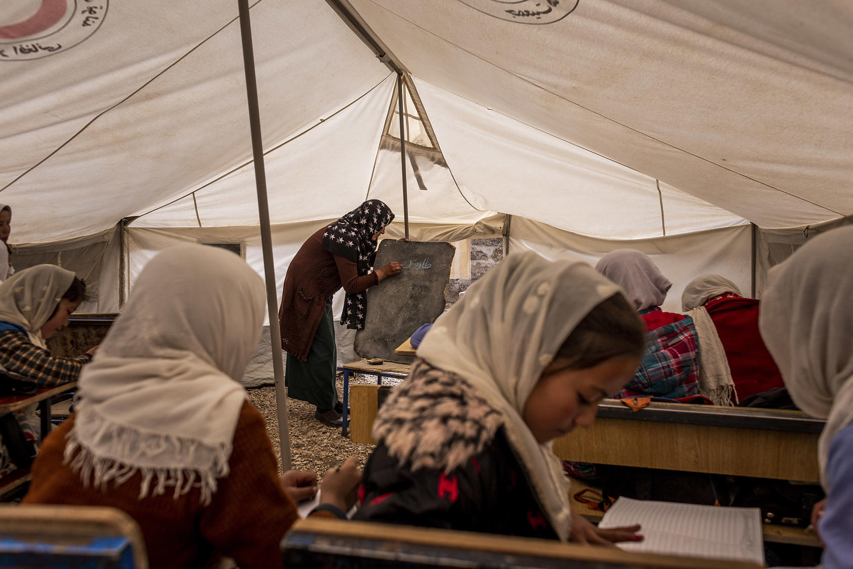 Girls study at a school housed in a tent in central Afghanistan. Afghan women leaders vow to work to preserve education for women and girls in any negotiations with the Taliban over the country's future. (Jim Huylebroek/The New York Times)