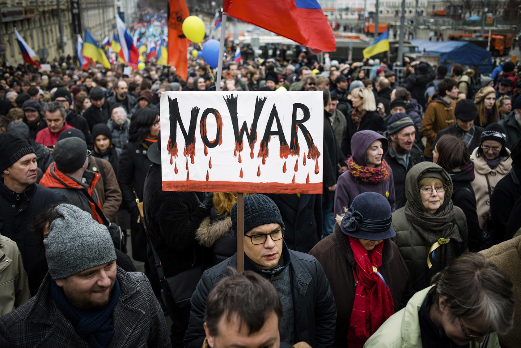 "A demonstrator holds a sign opposing war in Ukraine during a ""March for Peace"" rally in Moscow. (Dmitry Kostyukov/The New York Times)"