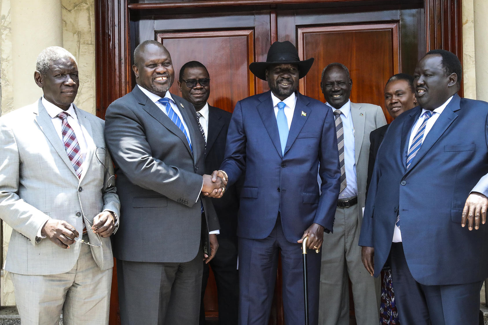 Salva Kiir (center right), president of the Republic of South Sudan, shakes hands with Riek Machar, opposition leader, at the Presidential Palace in Juba, Sept. 11, 2019 (UN Photo/Isaac Billy)
