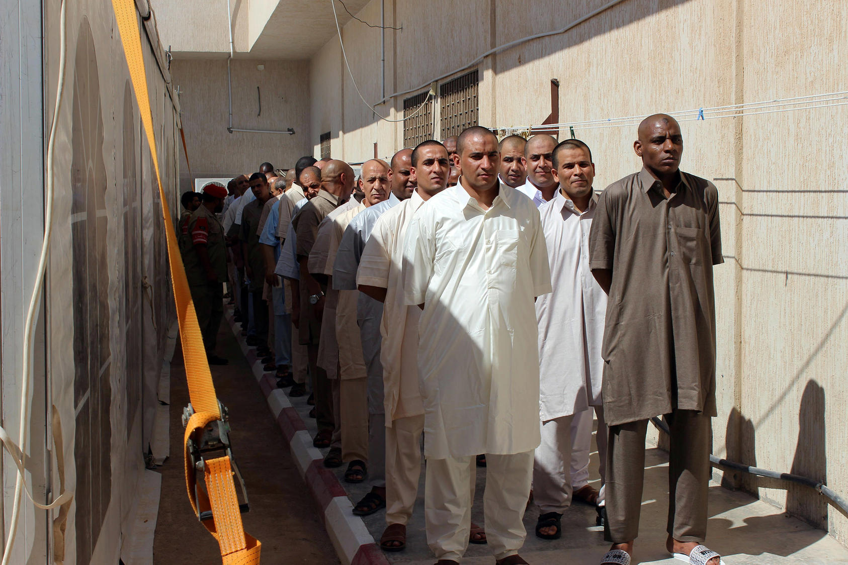 Gadhafi-era prisoners line up in queues ahead of their release in Misrata, Libya, in August 2017. (Ayman al-Sahili/Reuters)