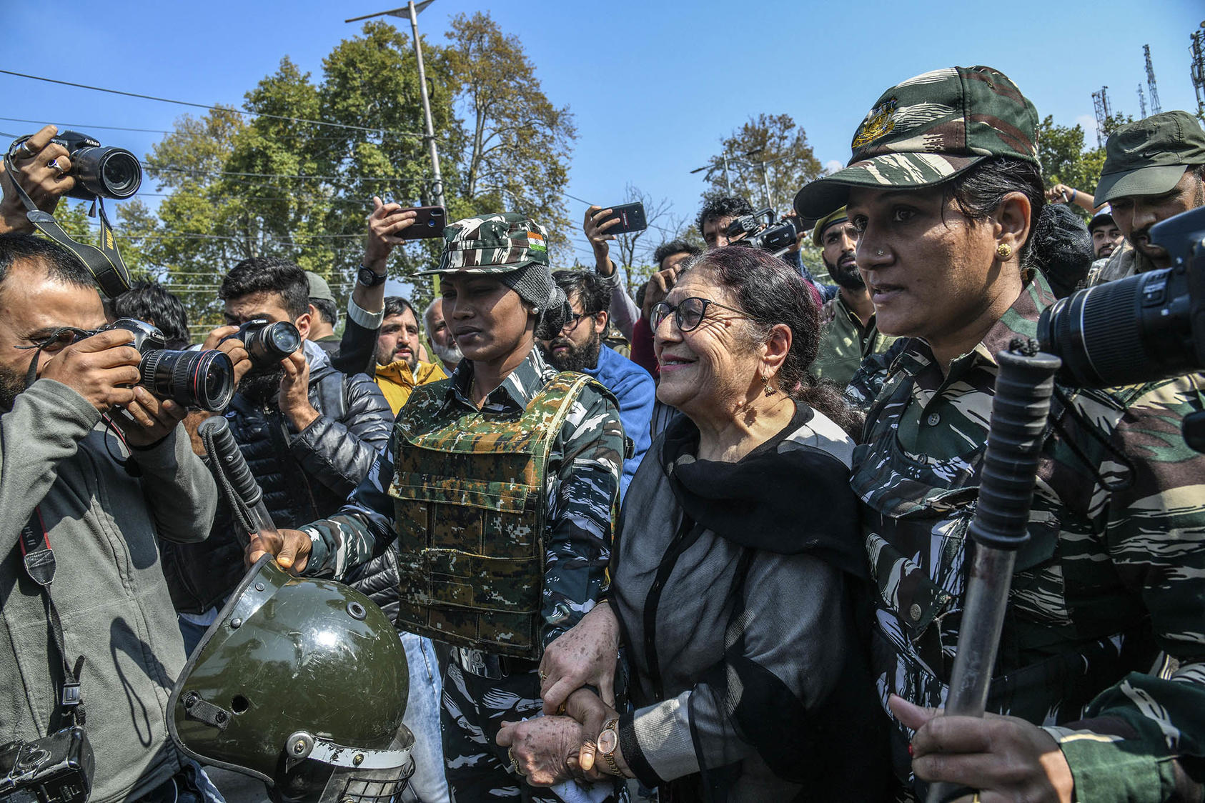 Indian security forces arrest one of a group of Kashmiri women who rallied in protest October 15 against the continued detention of Kashmiri political leaders, part of India's crackdown in the region. (Atul Loke/The New York Times)