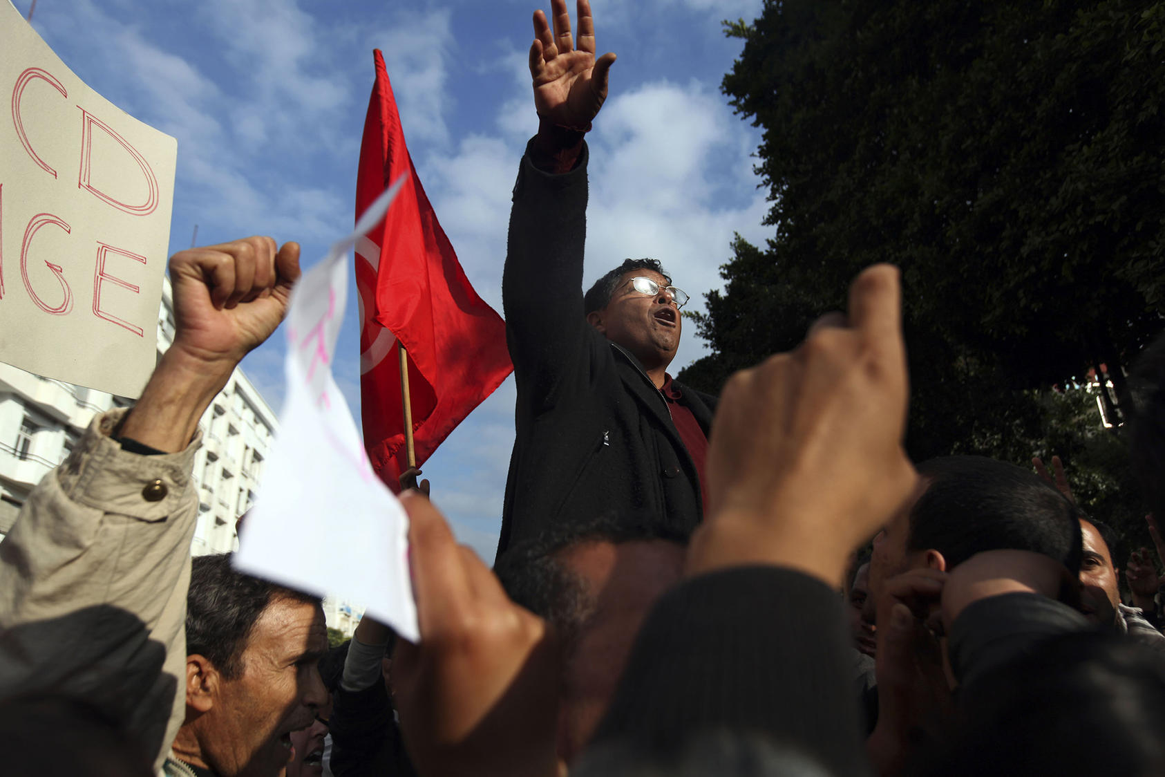 Demonstrators sing the Tunisian National Anthem during a protest in Tunis, Tunisia, Jan. 19, 2011. (Holly Pickett/The New York Times)