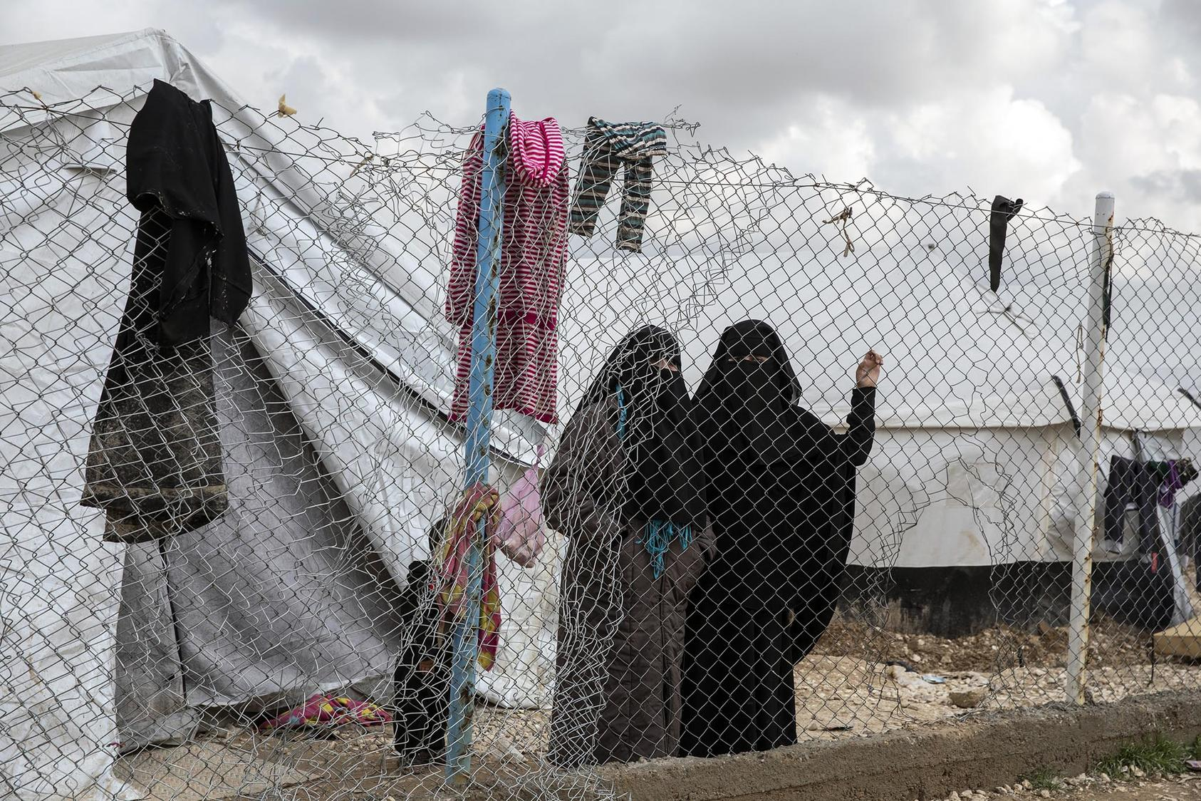 Women who fled the Islamic State's last areas of control in Syria at the Al Hol camp in northern Syria on March 28, 2019. (Ivor Prickett/The New York Times)