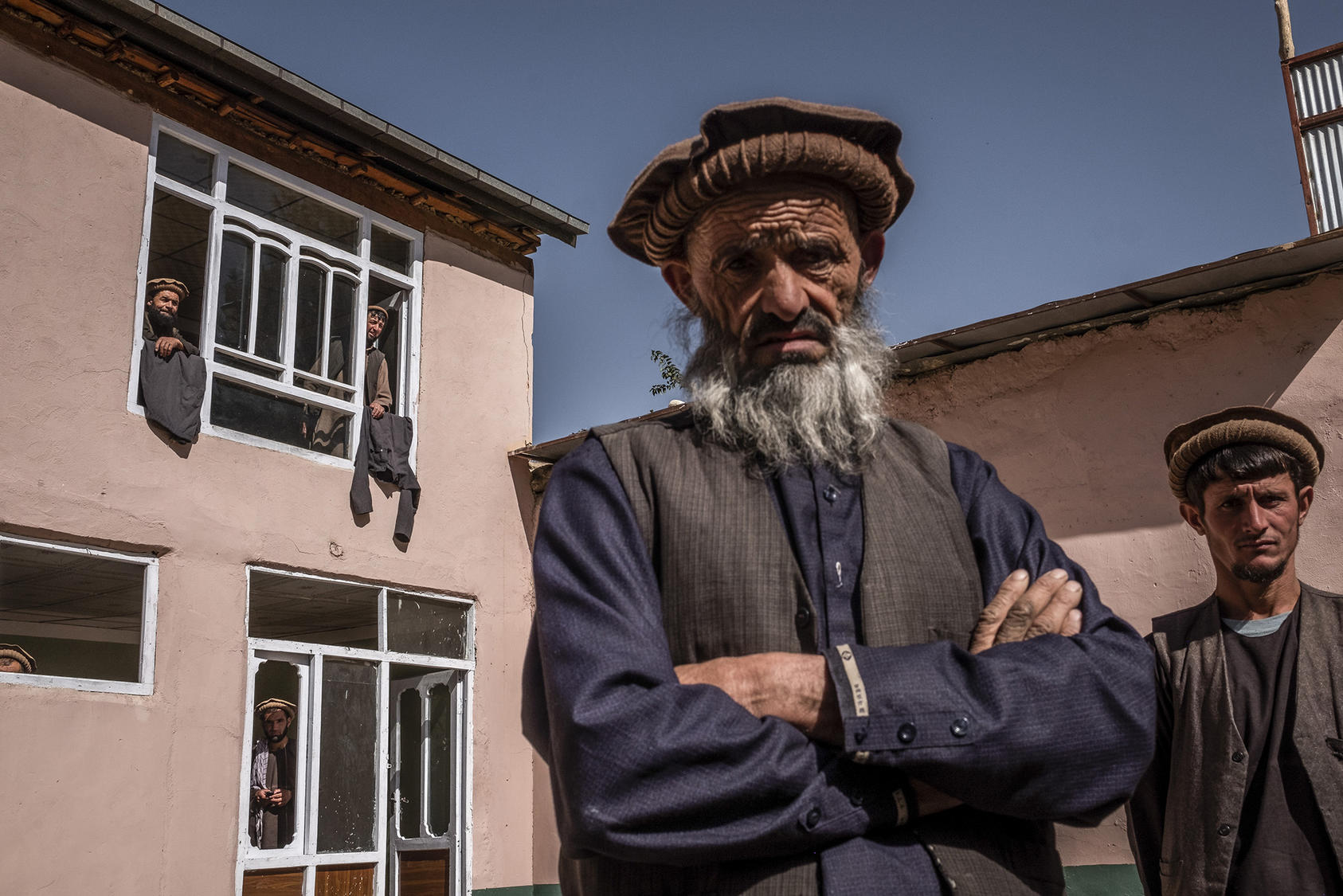 Mohammad Hassan, 65, inside a guarded compound in Faizabad, Afghanistan, Sept. 19, 2019. Hassan said he battled against the Soviets in the 1980s and government troops this year while fighting for the Taliban. (Jim Huylebroek/The New York Times)