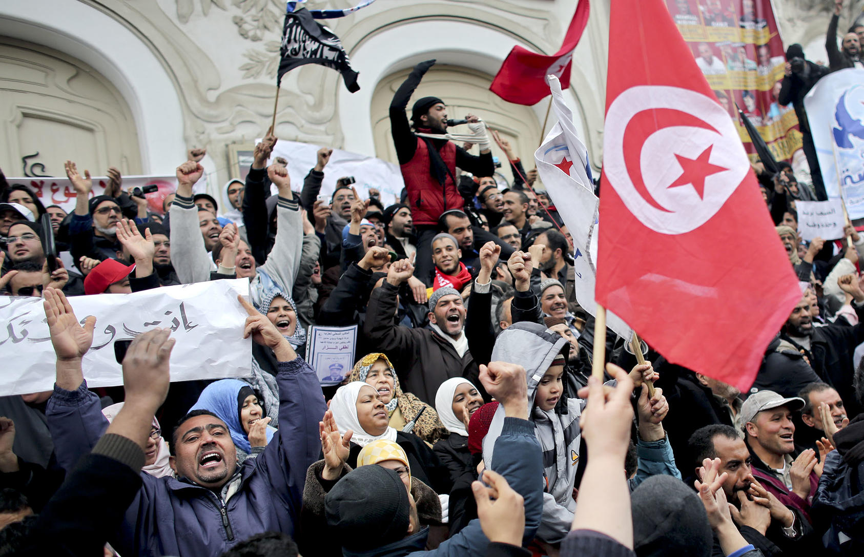People demonstrate in support of Ennahda, Tunisia's largest Islamist party, which led a governing coalition, in Tunis, Tunisia, Feb. 9, 2013. (Tara Todras-Whitehill/The New York Times)