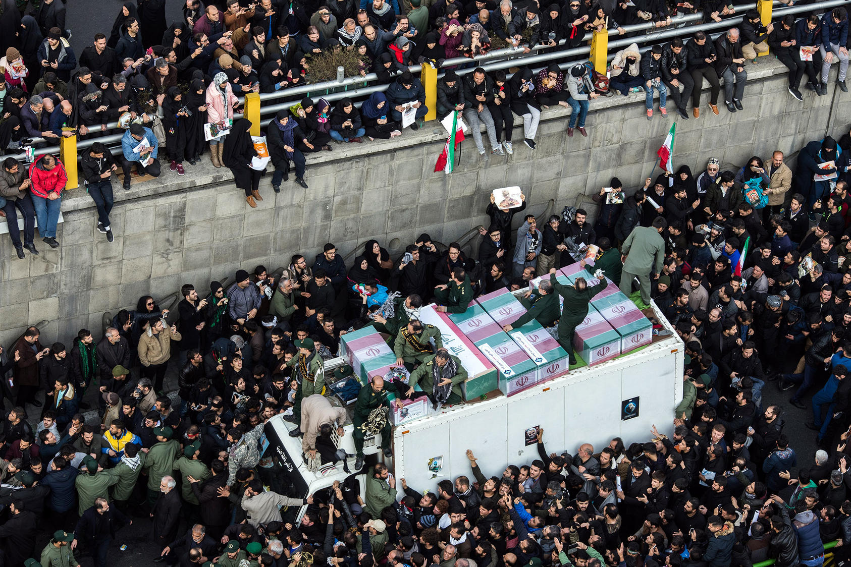 The coffins of Maj. Gen. Qassem Soleimani and others are carried on a truck through Tehran during a funeral procession on Monday, Jan. 6, 2019. (Arash Khamooshi/The New York Times)