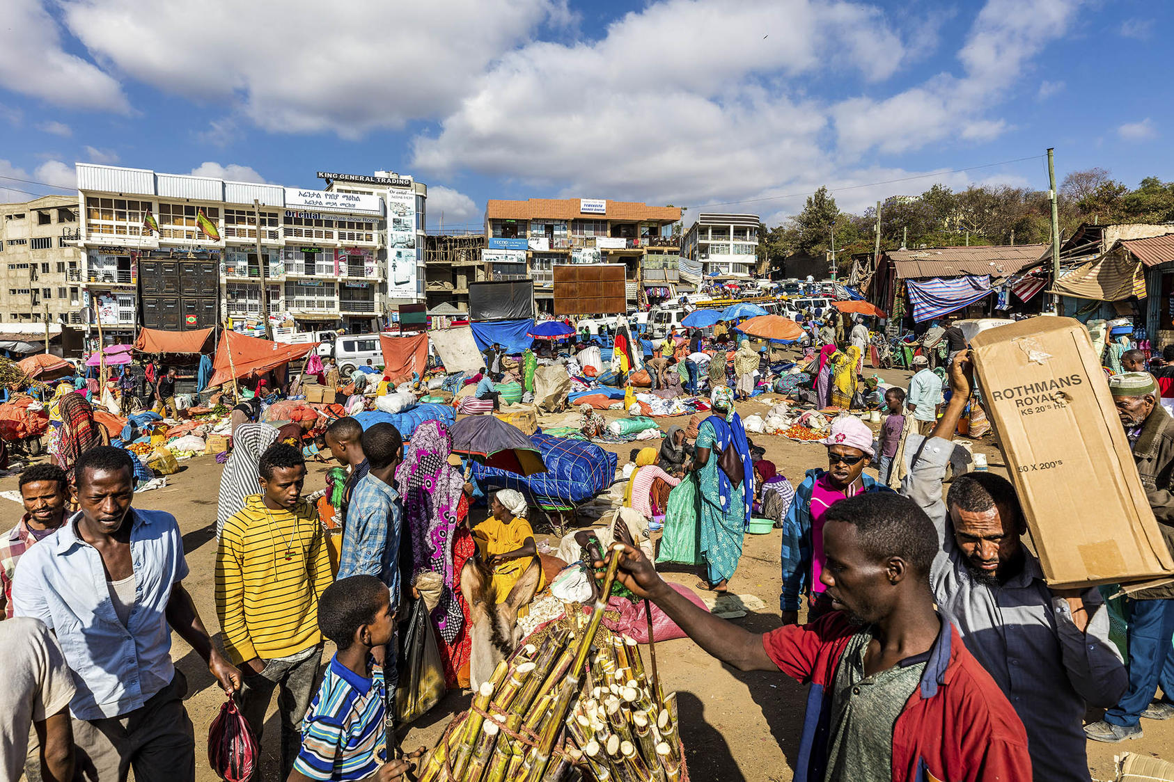 Throngs of shoppers and traders in the Christian market, outside the Showa Gate of Harar Jugol, Ethiopia, Feb. 10, 2019. (Marcus Westberg/The New York Times)