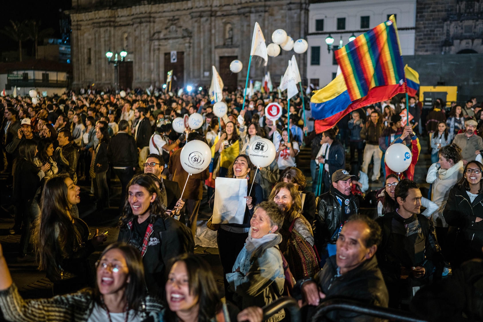 People in Bogota celebrate the peace agreement between the government and the FARC on Sept. 26, 2016. (Federico Rios Escobar/The New York Times)