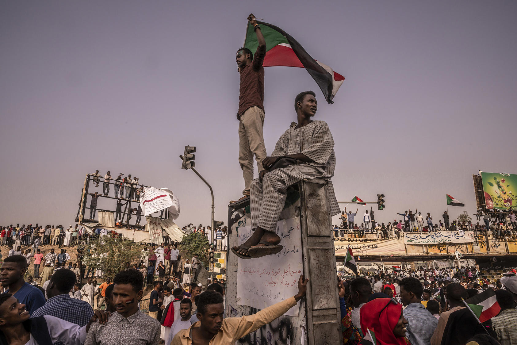 Protesters at the site of a sit-in outside the military headquarters in Khartoum, Sudan, April 19, 2019. (Bryan Denton/The New York Times)