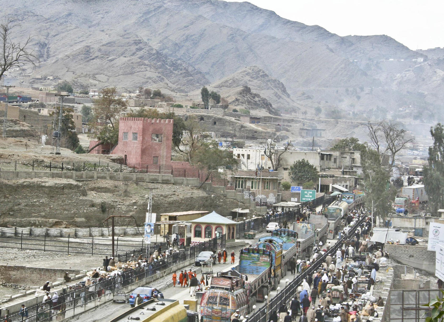 Trucks, traders and travelers cross between Afghanistan and Pakistan at Torkham, in the Khyber Pass, the country's busiest border crossing. Customs duties are a major source of the nation's revenue. (Ryan Matson/U.S. Army)