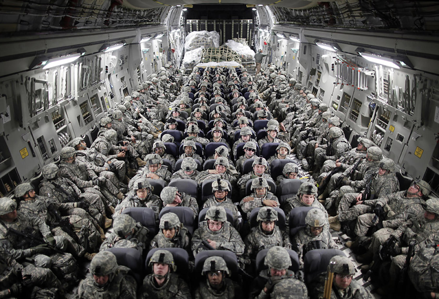 American soldiers on a transport plane that is about to land in Mazar-i-Sharif, in northern Afghanistan, April 5, 2010. (Damon Winter/The New York Times)