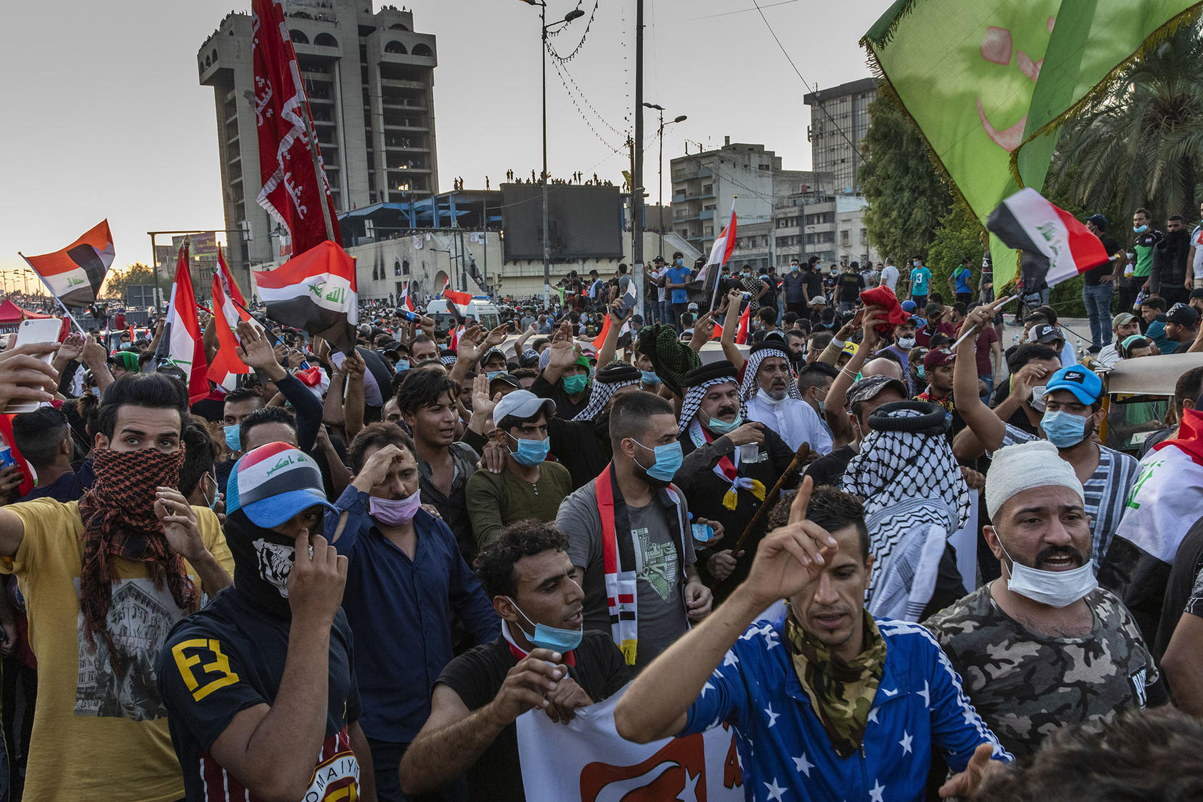 Protesters fill Tahrir Square in Baghdad, Oct. 26, 2019. Mass protests are declining worldwide in response to the COVID-19 pandemic, so movements are adapting their tactics in response to a changing world. (Ivor Prickett/The New York Times)