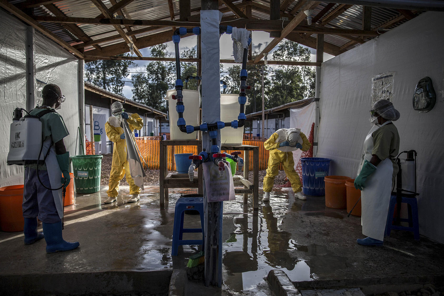 Ebola responders go through decontamination at a treatment center in Katwa, Congo, May 14, 2019. (Finbarr O'Reilly/The New York Times)