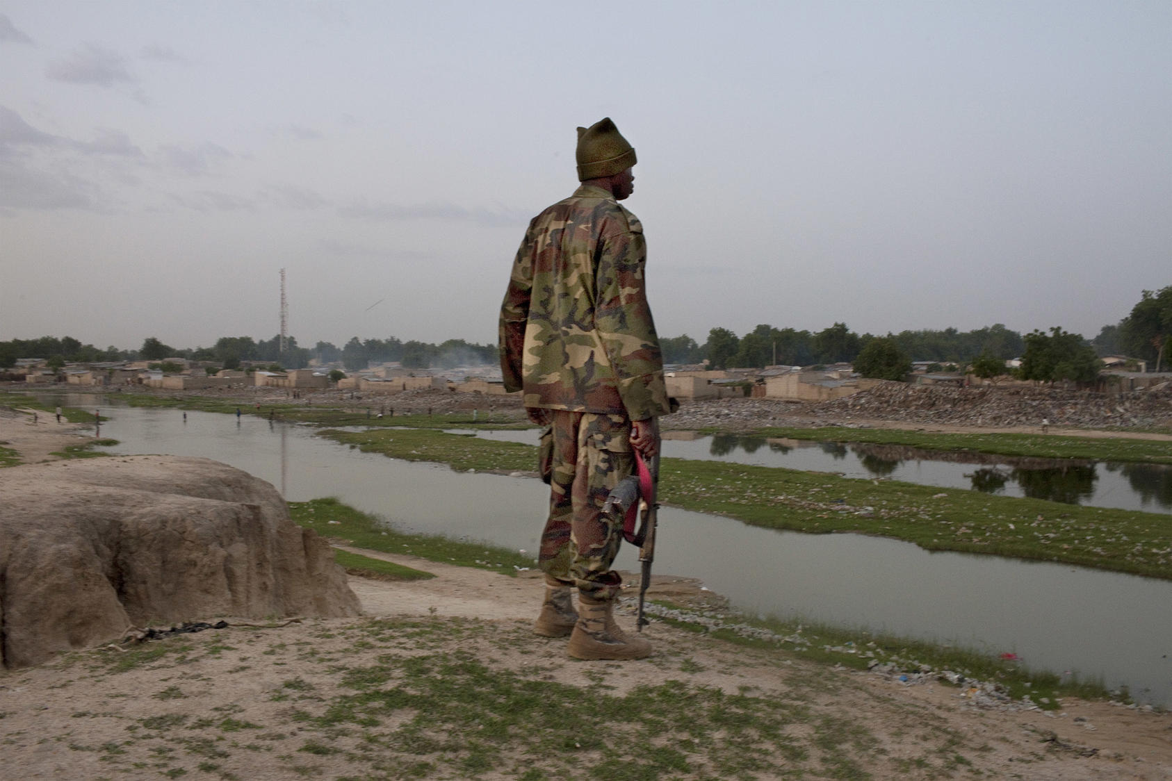 A soldier stands guard in northeastern Nigeria early in the Boko Haram insurgency. Nigeria's responses to violent conflict have focused on military and police operations, with less focus on prevention efforts. (Samuel James/The New York Times)