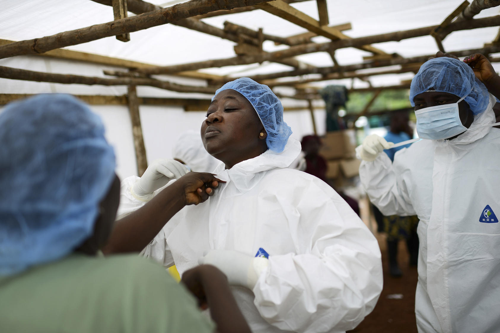 Josephine Finda Sellu, deputy nurse matron at a government hospital, before going into the isolation area for Ebola patients, in Kenema, Sierra Leone, Aug. 20, 2014. (Samuel Aranda/The New York Times)