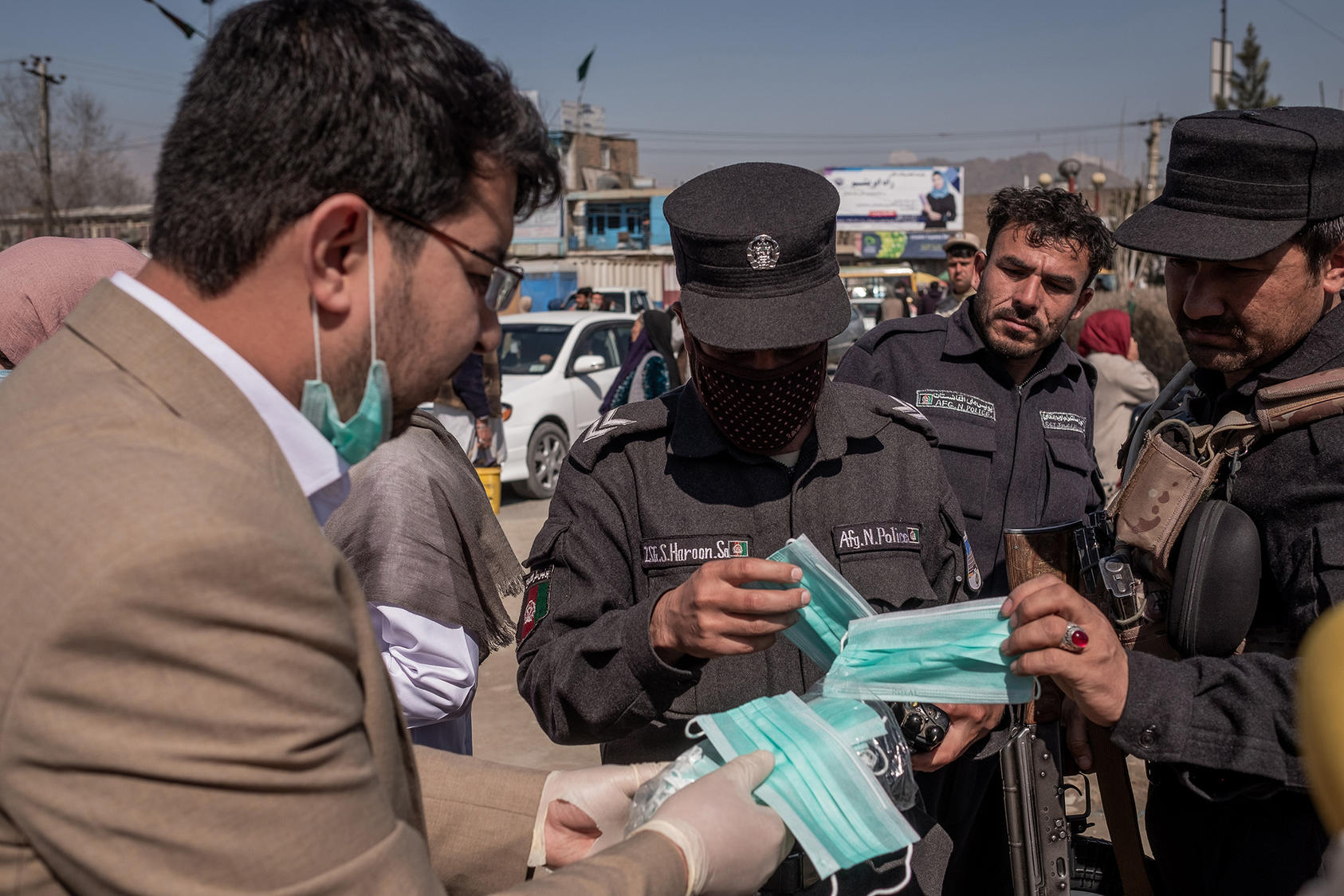 Activists hand out masks, gloves and hand sanitizer in Kabul, Afghanistan, on March 18, 2020. (Jim Huylebroek/The New York Times)