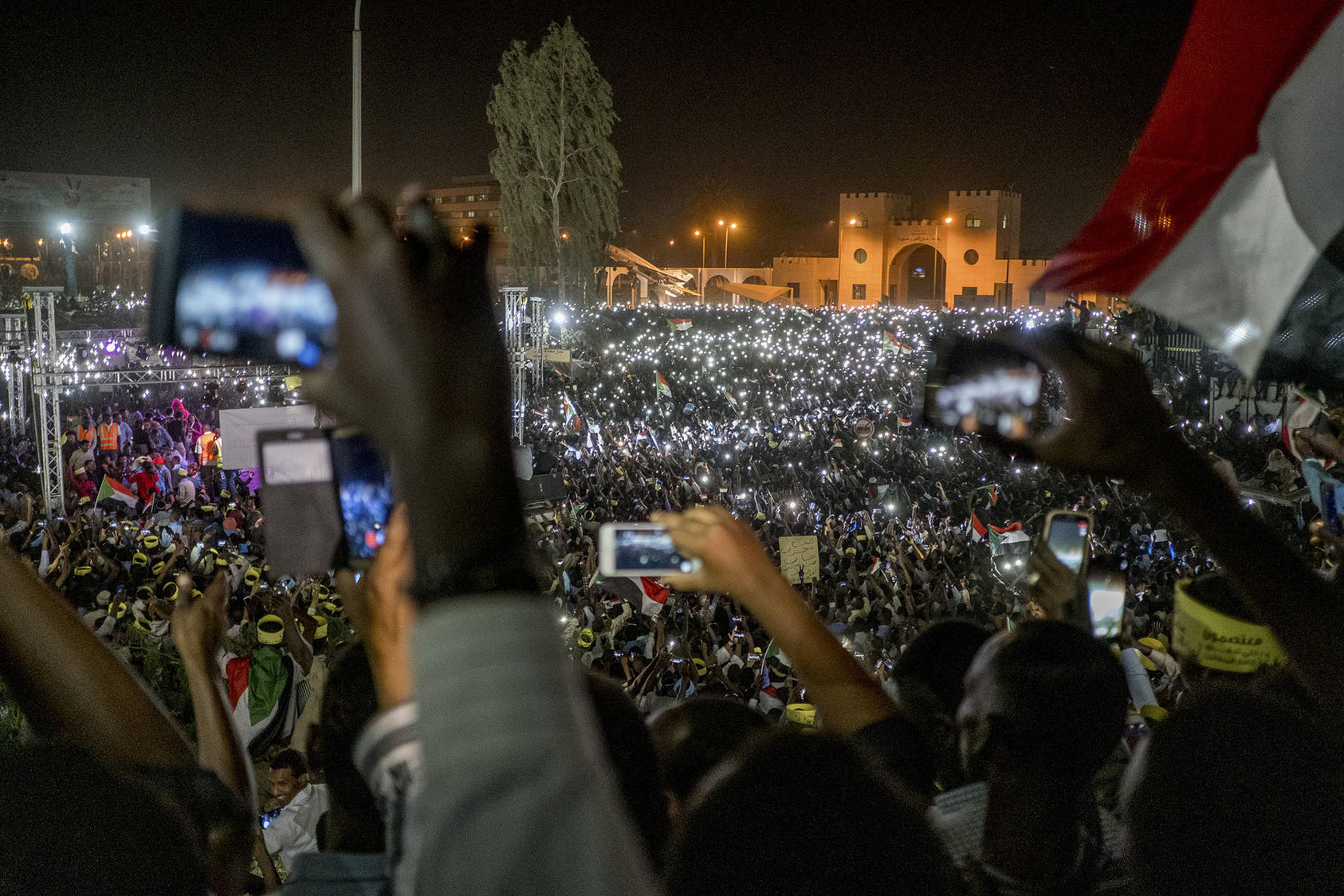 Protesters at a night rally outside the military headquarters in Khartoum, Sudan, April 21, 2019. (Declan Walsh/The New York Times)