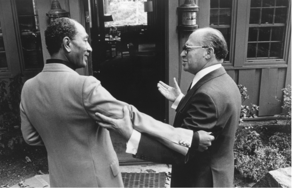 The power of personal peacemaking: After getting to know each other at Camp David in 1978, old foes—Egypt's Anwar Sadat, left, and Israel's Menachem Begin—each insisted that the other precede him into talks with President Jimmy Carter. (Bill Fitz-Patrick)