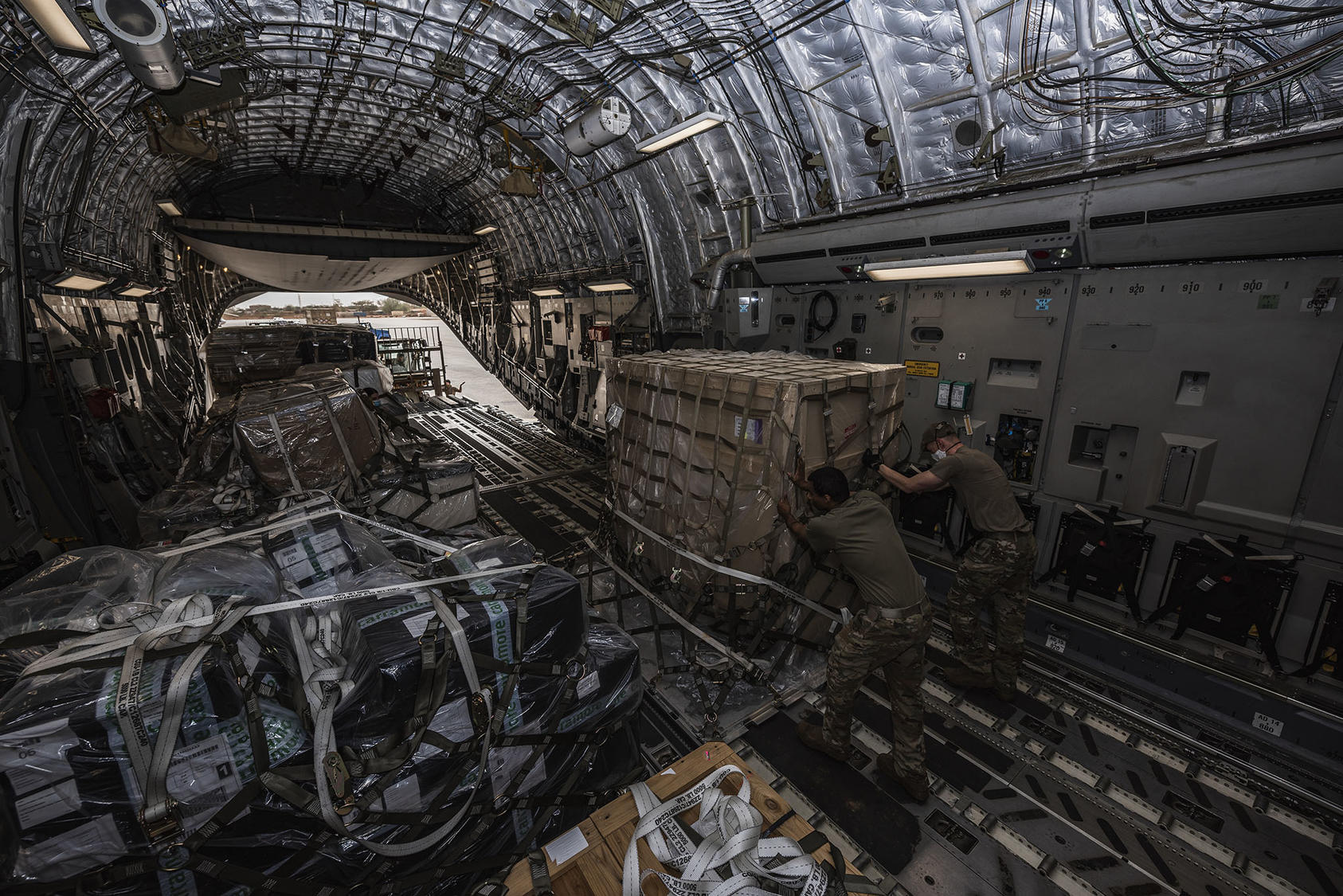 U.S. Air Force Airmen unload 4,000 pounds of medical supplies to be delivered to the Government of Ghana, Niamey, Niger, April 23, 2020. (Staff Sgt. Devin Nothstine/U.S. Airforce)