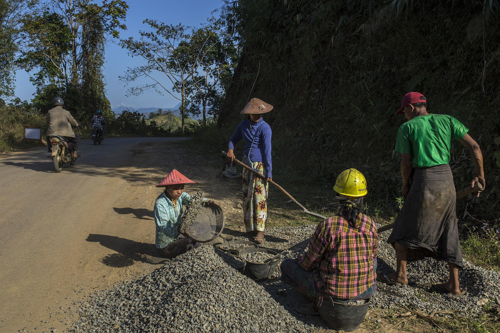 People do road work along the Irrawaddy River, where the Chinese-backed Myitsone Dam project (now suspended) is located in Myitkyina, Myanmar, March 22, 2017. (Minzayar Oo/The New York Times)