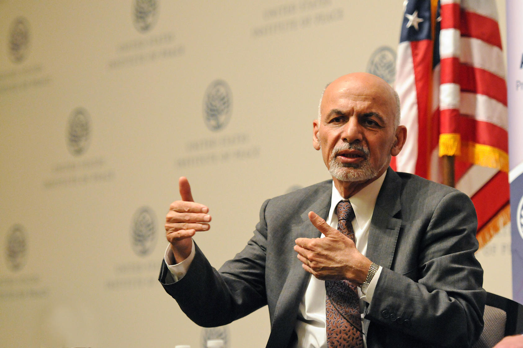 Afghan President Ashraf Ghani, shown speaking at USIP in 2015, announced new Taliban prisoner releases and laid out his vision for Afghanistan's peace process. He spoke in an online discussion from Kabul that was broadcast nationally in Afghanistan.