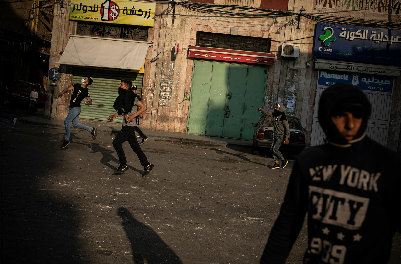 Antigovernment protesters clash with security forces in the northern city of Tripoli, Lebanon, April 29, 2020. (Diego Ibarra Sanchez/The New York Times)