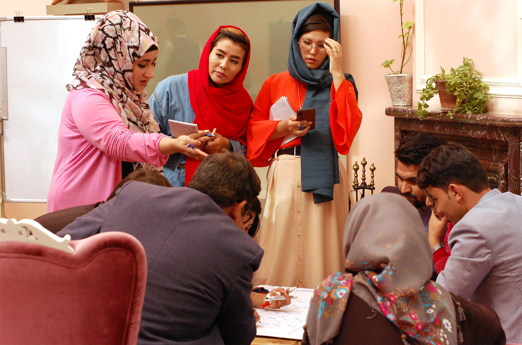 Afghans in the city of Mazar-i-Sharif discuss ways to build a national consensus on protecting women's rights in peace talks with the Taliban. The dialogue was one of a series hosted by USIP to broaden roles of women and youth in the peace process.