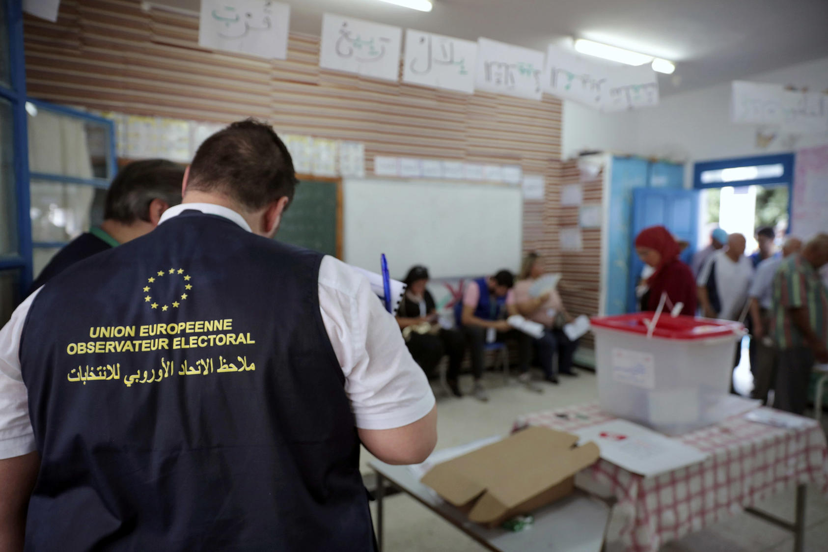 Observers from the European Union monitor the election process inside a polling station outside Tunis during the first round of the presidential election on September 15, 2019. (Mosa'ab Elshamy/AP)