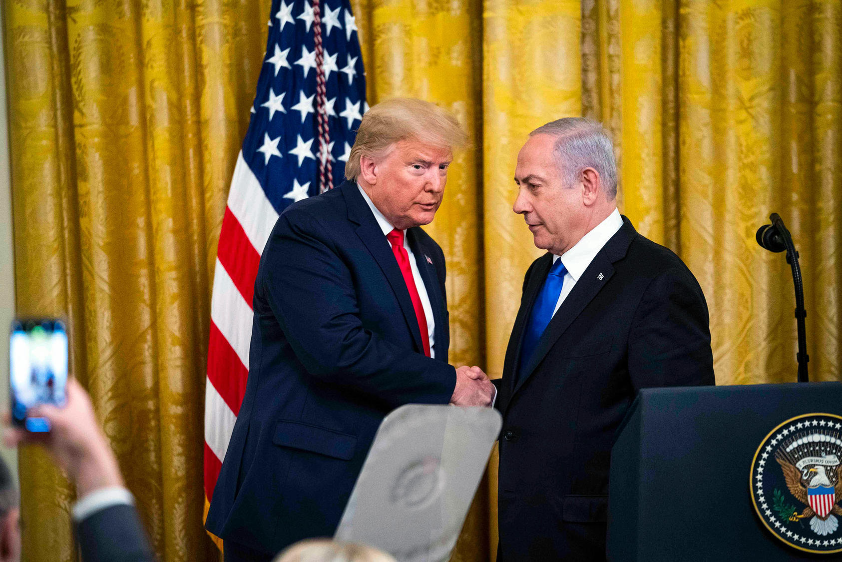 President Trump and Israeli Prime Minister Benjamin Netanyahu of Israel unveil Trump's Middle East peace plan at the White House in January 2020. (Doug Mills/The New York Times)