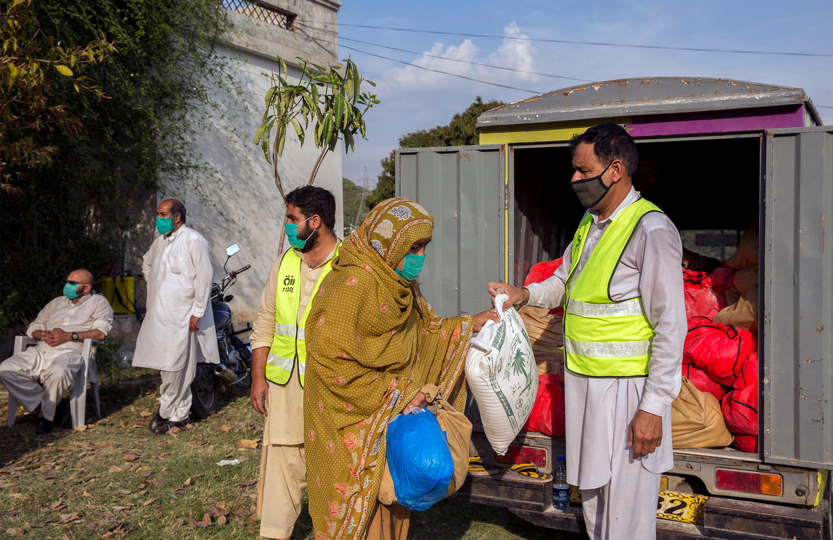 Groceries are delivered ahead of Ramadan in Islamabad, Pakistan, by Rizq, a charity organization, on April 24, 2020. The COVID-19 pandemic has exacerbated Pakistan's economic challenges. (Saiyna Bashir/The New York Times)