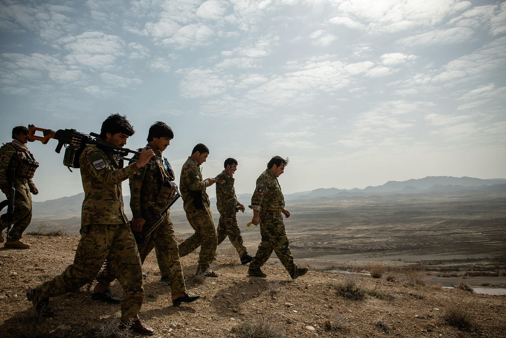 Lt. Col. Musa-Kalim Rodwal, the commander of an Afghan police unit, leads a group of police officers in Zabul Province, in Afghanistan on Sunday, Feb. 23, 2020. (Kiana Hayeri/The New York Times)