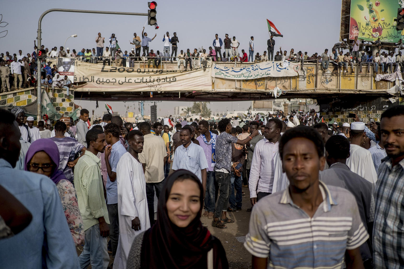 Young Sudanese rally for democracy at Sudan's military headquarters in 2019. The nonviolent ouster of longtime ruler Omar al-Bashir is one of many citizens' movements demanding more accountable governance across Africa. (Declan Walsh/The New York Times)