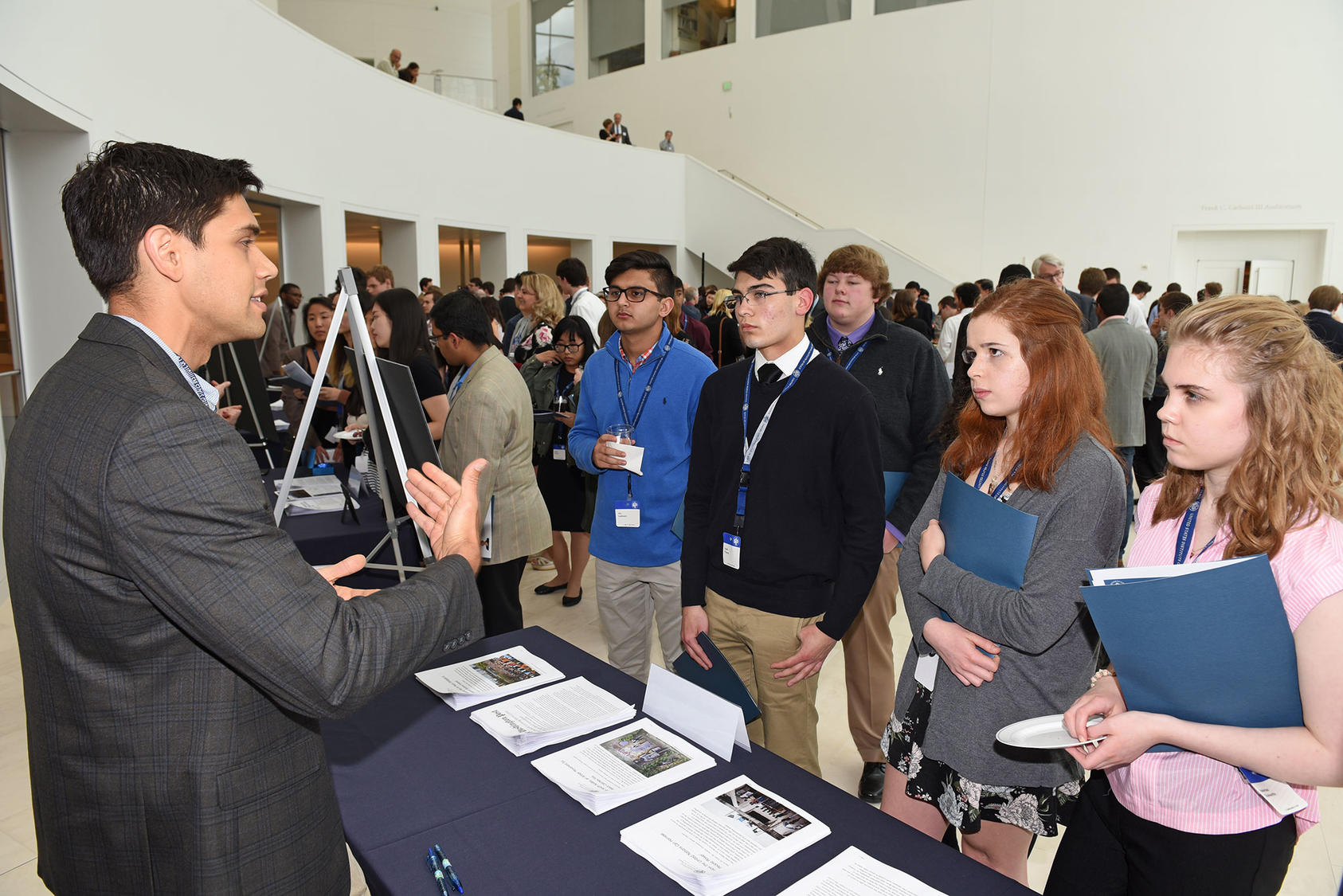 USIP staff engage with an audience of students, teachers, and parents from 25 U.S. states at the 2018 national competition reception for Academic WorldQuest, a program of the World Affairs Councils of America, which USIP sponsors.