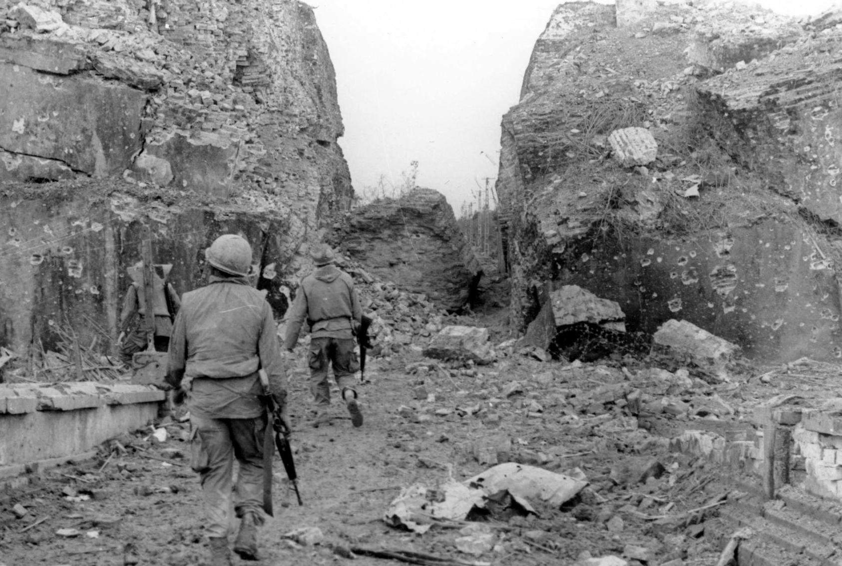 U.S. troops patrol along the shattered ancient walls of the Vietnamese city of Huế during the North Vietnamese 1968 Tet Offensive. That campaign was the bloodiest phase of two decades of war in Vietnam. (U.S. Army)