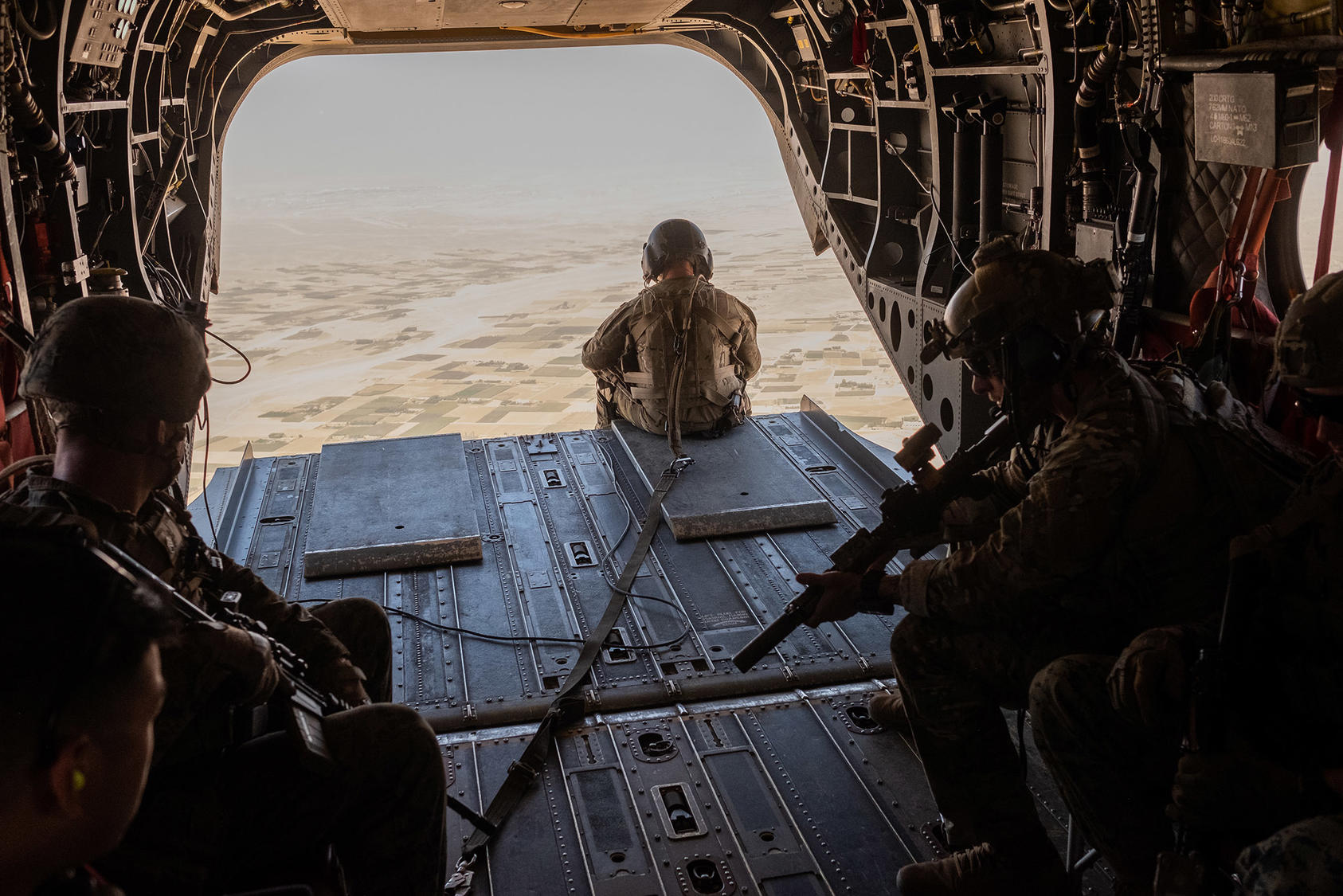 U.S. troops in a helicopter above Helmand Province in Afghanistan Sept. 26, 2019. (Jim Huylebroek/The New York Times)