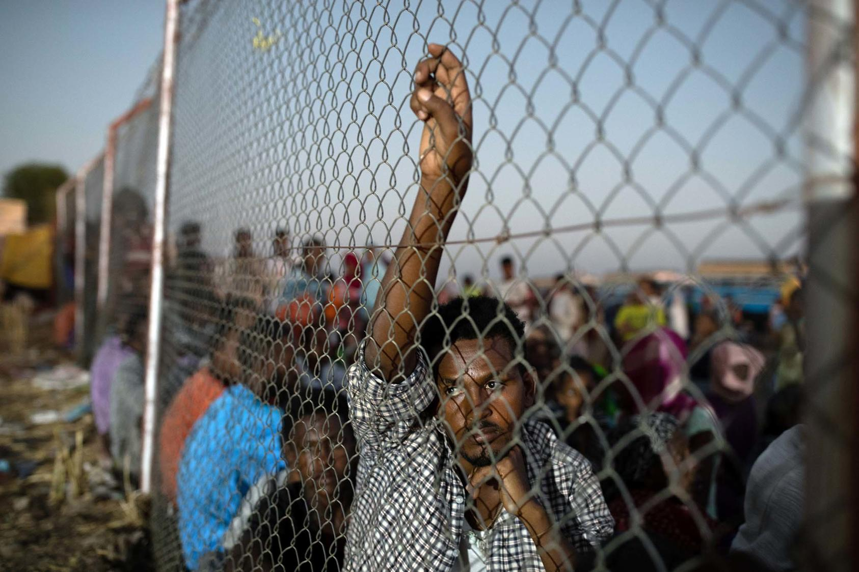 Ethiopian refugees wait for relief supplies at a United Nations compound in Hamdayet, Sudan, on Saturday, Dec. 5, 2020. (Tyler Hicks/The New York Times)
