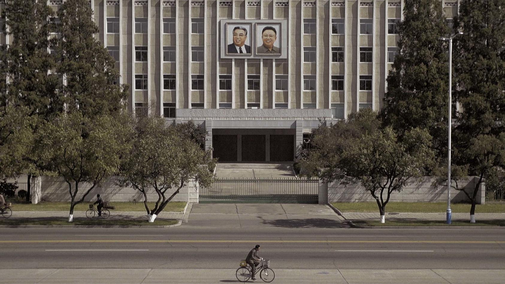 Portraits of Kim Il-Sung, the founder of North Korea and his son, Kim Jong-il, hang on a building in the capital, Pyongyang, Sept. 29, 2017. (Jonah M. Kessel/The New York Times)