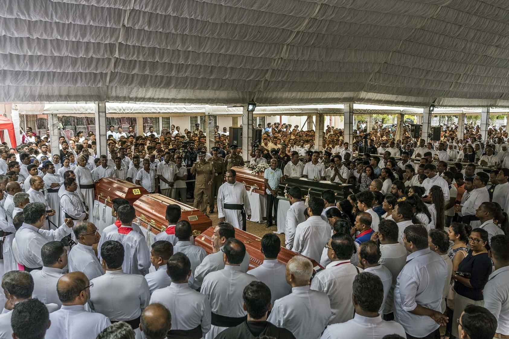 A mass funeral on Tuesday, April 23, 2019, at St. Sebastian's Church in Negombo, Sri Lanka. (Adam Dean/The New York Times)