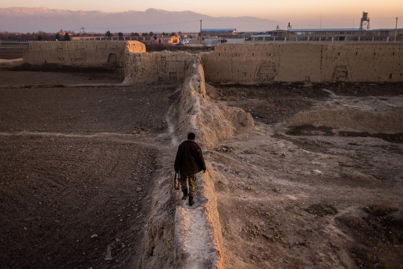 An Afghan policeman in Mazar-i-Sharif, a northern city in Afghanistan, on Jan. 17, 2021. The Taliban's rapid seizure of rural parts of northern Afghanistan has countries in the region preparing for the militiant group to control Afghanistan. (Jim Huylebroek/The New York Times)